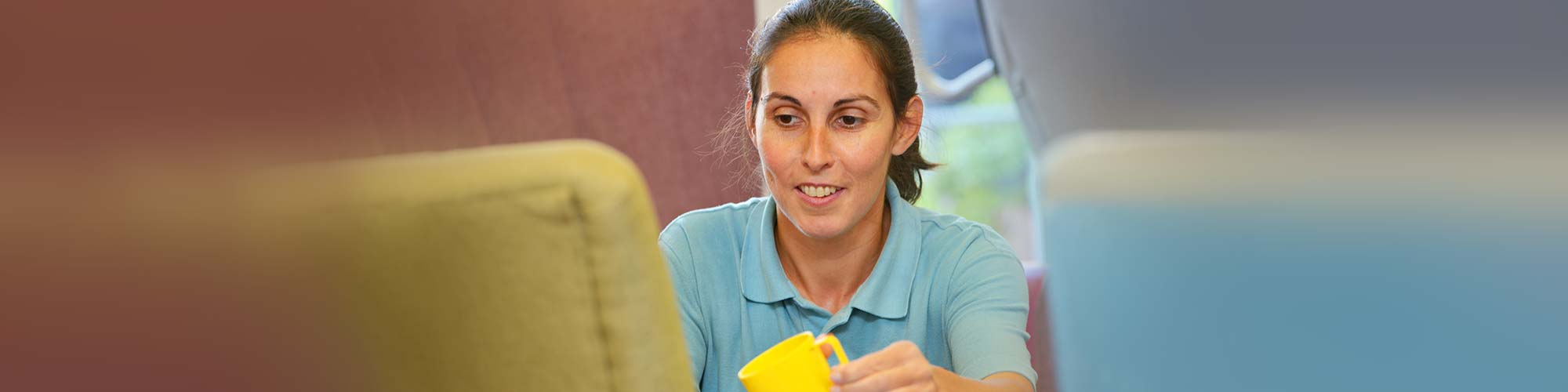 Cornerstone Carer offering a drink to resident