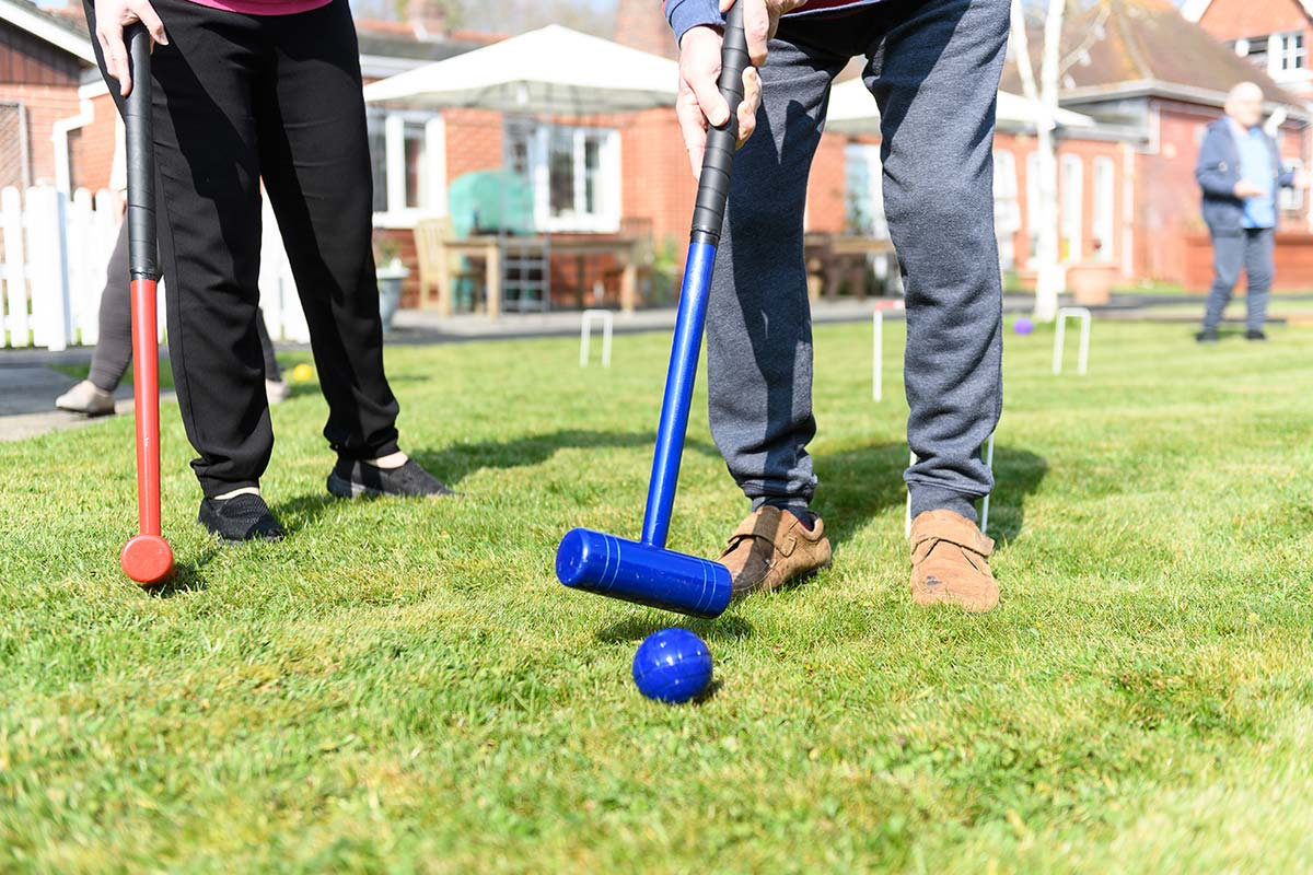 Cornerstone Residents playing croquet