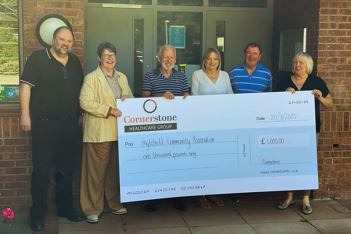 Cornerstone and Mytchett Community Centre Team with cheque