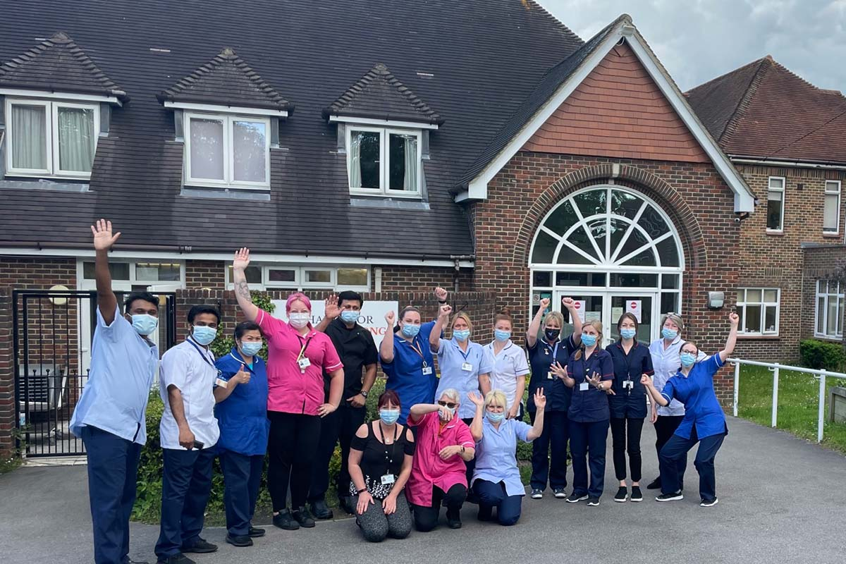 Cornerstone Staff celebrating in front of South Africa Lodge Nursing Home